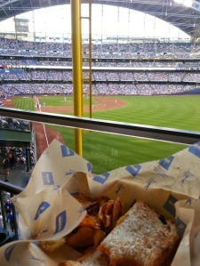 Grilled cheese for me and cheese curds for Vin. Baseball in Wisconsin!